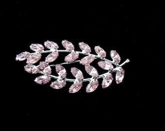 B. David Pink Rhinestone Laurel Leaf Brooch.  Beautiful delicate pink colored rhinestones set in a oval shape. Beautiful Vintage Brooch.