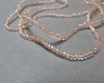 Sparkly Glass Rondelles. Faceted Rondelles. Clear. Rose Quartz Pink. 1.5mm-2mm. Full Strand. One (1).