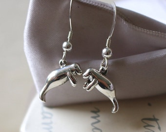 Sterling Manatee earrings with or without crystals added to earwires