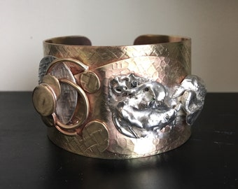 Handcrafted abstract design cuff