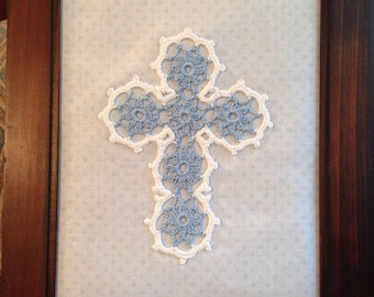 """Framed pale """"baby"""" blue (#25) and white crocheted cross"""