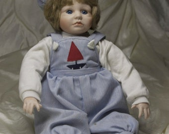 Porcelain Doll In Sailor Overalls