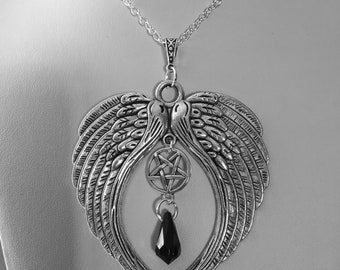 Gothic silver wings and pentagram necklace.