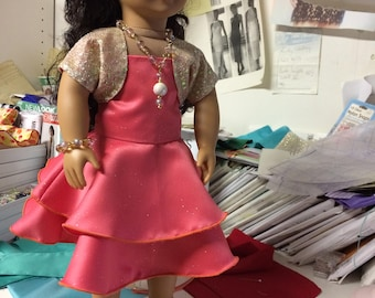 2 Tier peach satin sleeveless dress with sequin bolero.