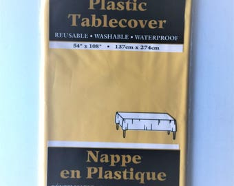 Large solid yellow plastic tablecloth
