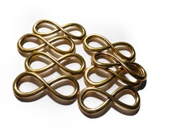 A set of 8 large gold infinity design pendant