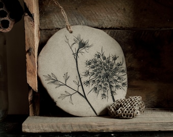 Round decorative stoneware wall tile with impression of Queen Anne's Lace.  Home decor. Rustic wall hanging.