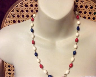 Red white and blue oval acrylic beads Hong Kong necklace.