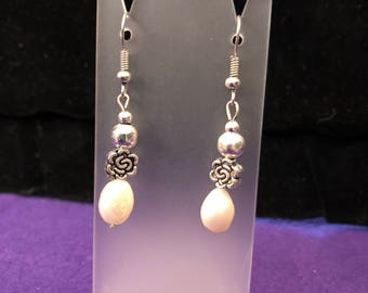 Silver toned and white pearl drop earrings.