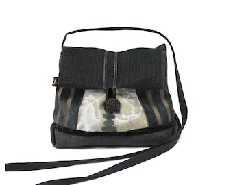 Small fabric partners, shoulder bag black and silver. Original clutch with flap. Light and practical bag.