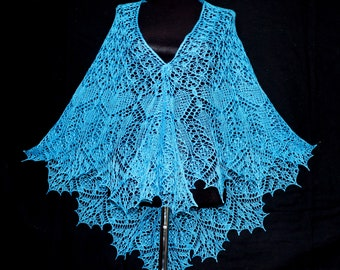 knitted shawl handmade shawl of wool very beautiful blue color lots of shiny beads Russian winter forest very warm and beautiful