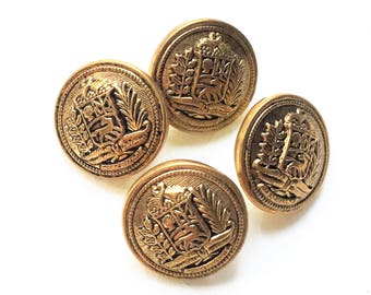 small eco friendly pristine antiqued gold tone metal shank buttons with detailed shield and frond picture design--matching lot of 4