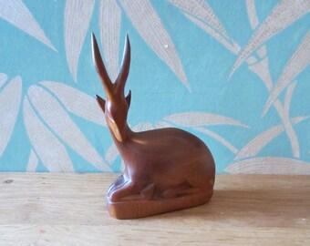 Vintage wooden antelope, sitting