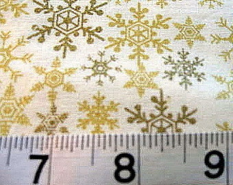 Delicate Snowflakes in Shades of Gold on Champagne Background - 1 Yard