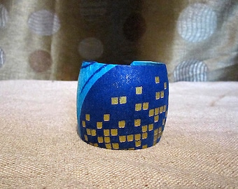 Women's Colorful African fabric cuff bracelet on an adjustable on a metal base.