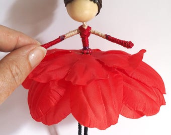 Flower fairy doll dressed in red.