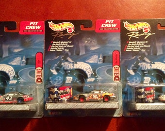Set of 3 Hot Wheels Pit crew seriesdie cast cars with rolling tool boxes