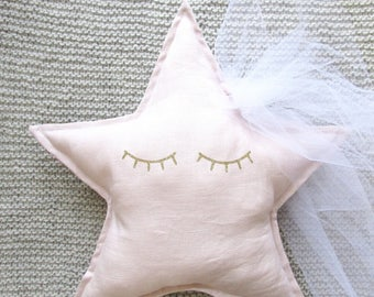 Shooting star nude linen pillow.