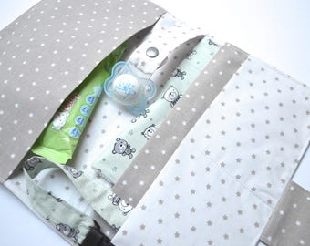 Diapers and beige napkins with stars
