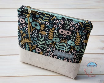 Floral cosmetic bag with white synthetic leather