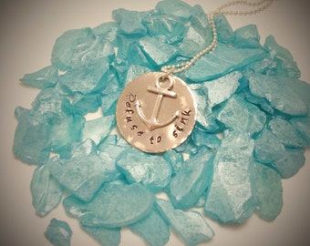 Refuse to sink Hand stamped metal necklace with anchor charm
