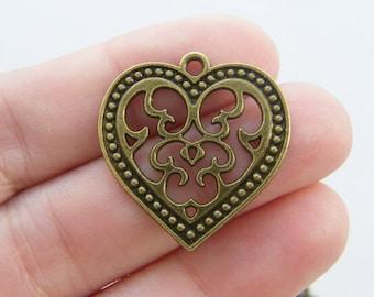 4 Heart charms antique bronze tone BC8