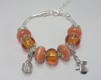 Orange charms bracelet with charms ref 506