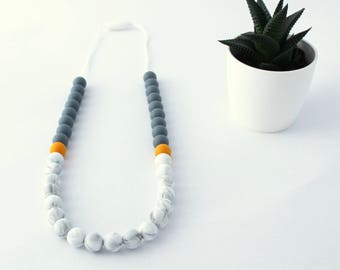 Teething necklace to chew on marble and mustard pattern Liam for MOM and baby, silicone
