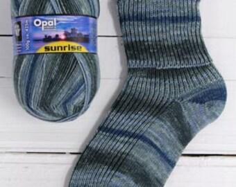 Denim sockyarn Opal Sunrise 4ply 425 meter (465 yards) in stunning colourway with light blue denim grey stripes shade nr. 9443