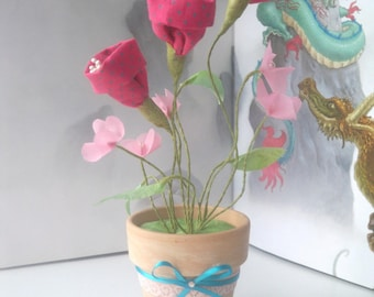 pot of tulips flowers and fushia pink tender