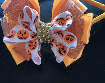 Beautiful orange bow with rhinestones.