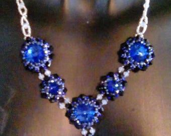 A blue fancy  pendant necklace