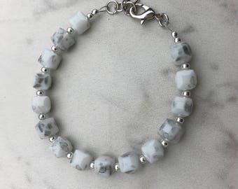 Silver and white single strand bracelet