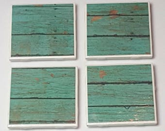 Ceramic coasters set with four each one is 4.25x4.25. Inches