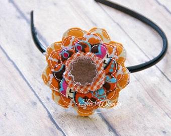 Fabric flower hair bow- Orange and brown hair clip
