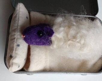 Easter Sleepy Sheep -purple. Needle felted. A new addition to the Tinny Tinies range. Complete with bed, bedding and adoption certificate.