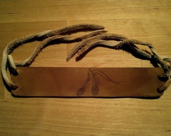 Leather wristband with feather burn drawing