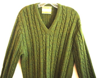 Luxurious vintage 60s olive green wool, cable knit pullover sweater. Made by The Country  Squire. Size XL.