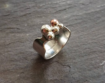 Sterling silver and copper granulation ring.