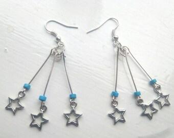 Blue star burst earrings