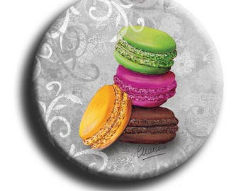 Magnet magnet depicting 4 macaroons on a gray background with arabesques in 38 mm