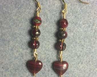 Ruby red Picasso Czech glass heart bead dangle earrings adorned with ruby red Picasso Czech glass beads.
