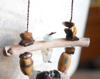 Long primitive sone, crystal, and wood necklace