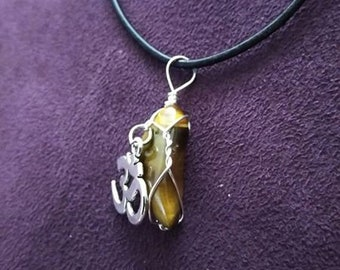 Tiger Eyes hand wired necklace with OM pendant.