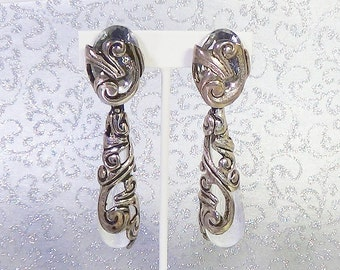 Silver and crystal drop earrings.  Charming for all occasions.