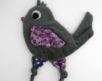 Flat plush bird.