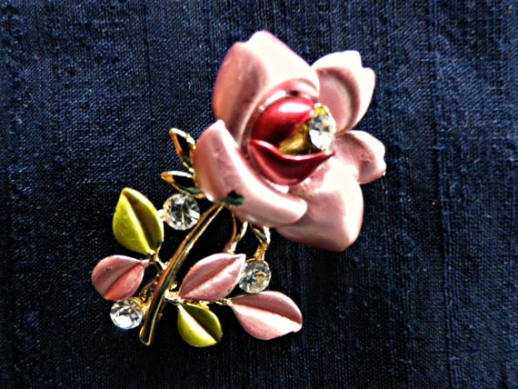 Small pink enamel rose brooch with white rhinestones in gold tone metal