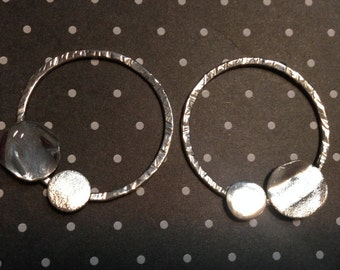 Silver hoop earrings with two asymmetrical circles