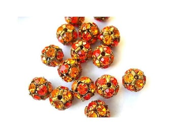 2 Vintage SWAROVSKI BEADS 8mm, orange shades crystals in brass setting creating ball bead