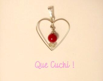 Pendentif en forme de cœur avec une perle de corail